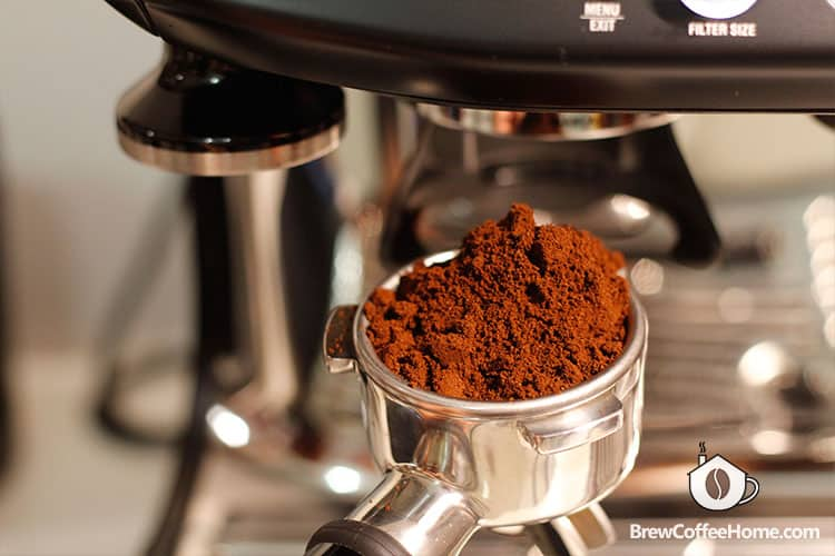 messy coffee grounds in portafilter
